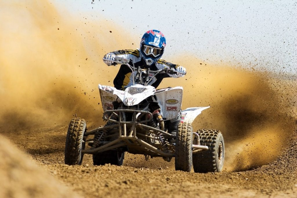 PIcture of someone going off-road with a quad bike.