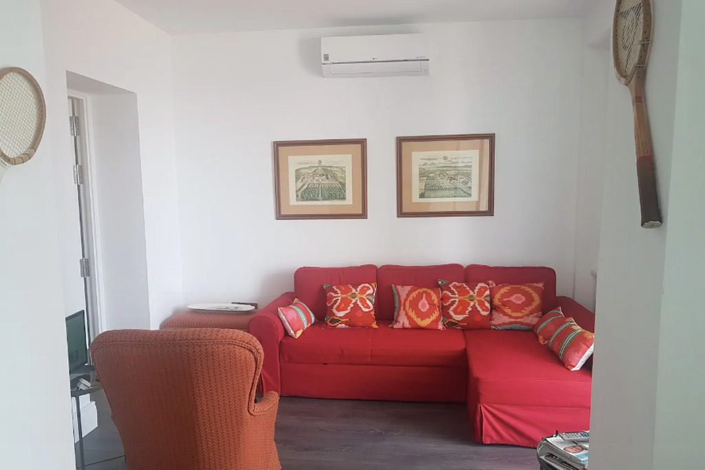 red couch in lounge of colonial apartment in Andalusia