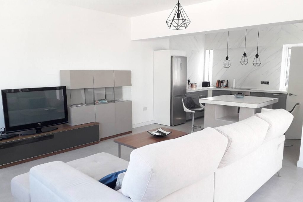 Clean white couch in penthouse apartment