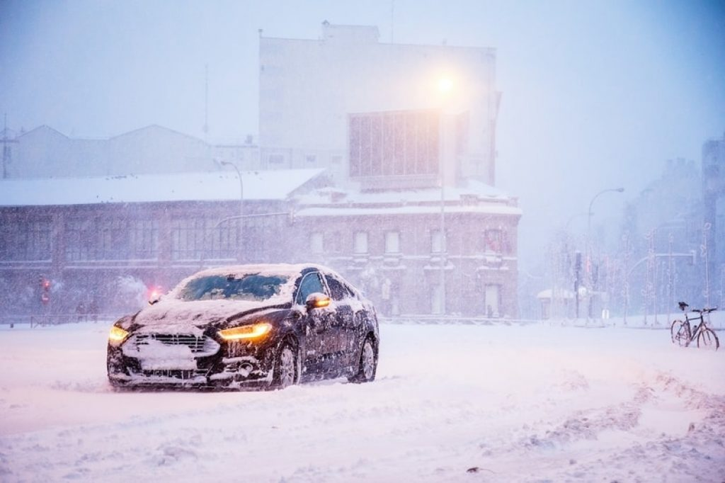 car-covered-in-snow-in-winter