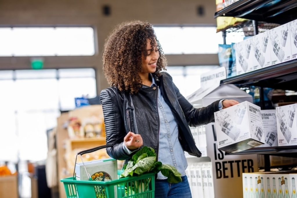 woman shopping for groceries with basket