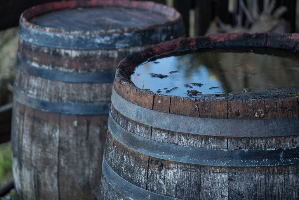 two-wine-barrels-side-by-side-filled-with-aging-red-wine-in-spain