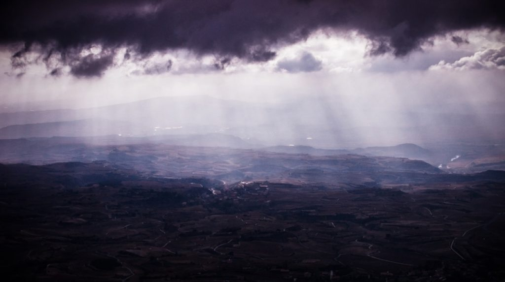 Storm clouds pass over the vineyards of Laguardia, Spain