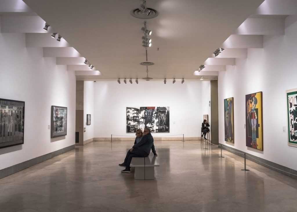 Couple looking at art inside museum