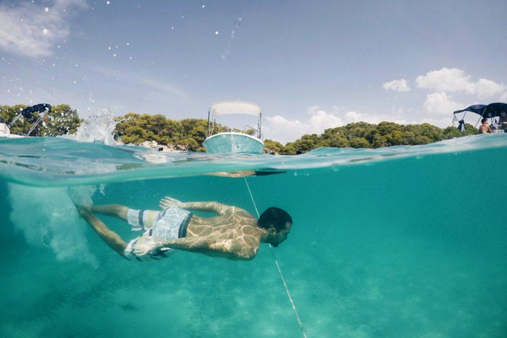 swimmer and boat menorca
